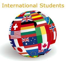 Globe_w_international_students_Dr_Paul Lowe_Admissions_Expert_Independent_Educational_Consultant